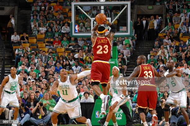 LeBron James of the Cleveland Cavaliers shoots the ball against Glen Davis of the Boston Celtics in Game Three of the Eastern Conference Semifinals...
