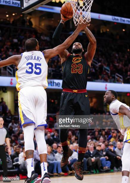 LeBron James of the Cleveland Cavaliers shoots the ball against Kevin Durant of the Golden State Warriors at Quicken Loans Arena on January 15 2018...