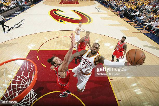 LeBron James of the Cleveland Cavaliers shoots the ball against Joakim Noah of the Chicago Bulls in Game One of the Eastern Conference Semifinals...