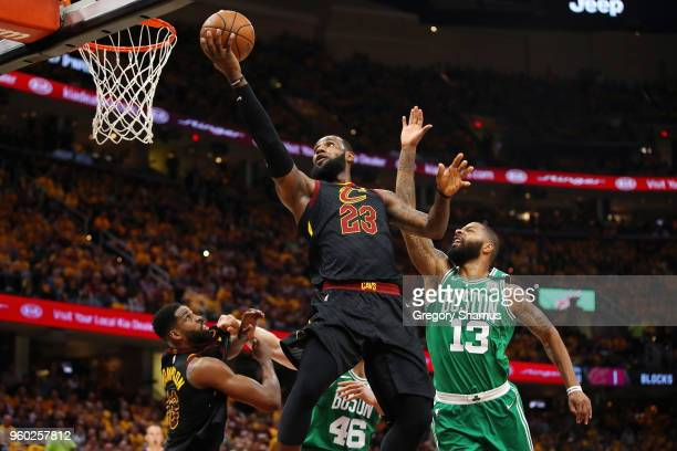 LeBron James of the Cleveland Cavaliers shoots the ball against Marcus Morris of the Boston Celtics in the first half during Game Three of the 2018...
