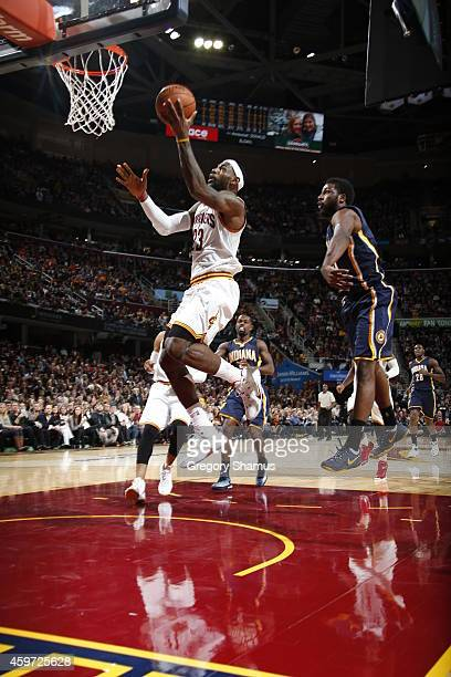 LeBron James of the Cleveland Cavaliers shoots the ball against the Indiana Pacers during the game on November 29 2014 at Quicken Loans Arena in...