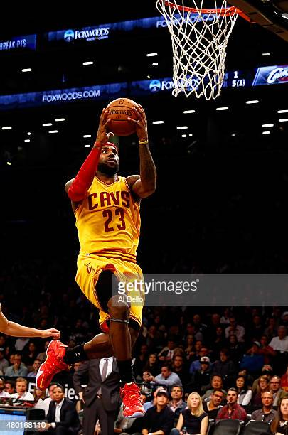 LeBron James of the Cleveland Cavaliers shoots the ball against the Brooklyn Nets during their game at Barclays Center on December 8, 2014 in the...