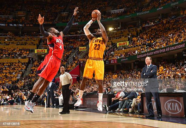 LeBron James of the Cleveland Cavaliers shoots the ball against the Atlanta Hawks at the Quicken Loans Arena During Game Four of the Eastern...
