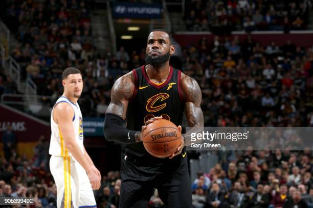 LeBron James of the Cleveland Cavaliers shoots the ball against the Golden State Warriors on January 15 2018 at Quicken Loans Arena in Cleveland Ohio...