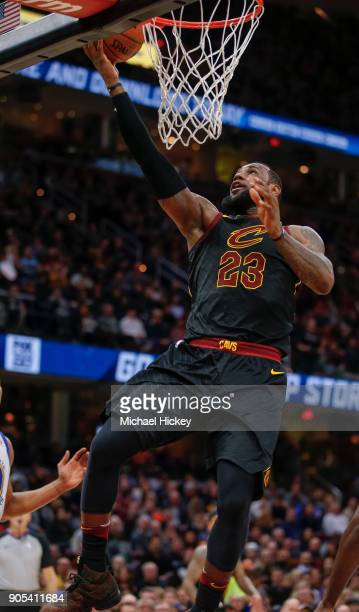 LeBron James of the Cleveland Cavaliers shoots the ball against the Golden State Warriors at Quicken Loans Arena on January 15 2018 in Cleveland Ohio...