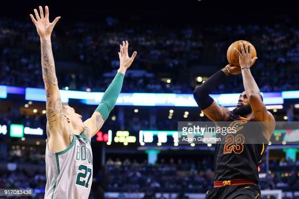 Lebron James of the Cleveland Cavaliers shoots the ball as he guarded by Daniel Theis of the Boston Celtics during a game at TD Garden on February 11...