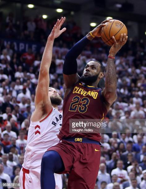LeBron James of the Cleveland Cavaliers shoots the ball as Jonas Valanciunas of the Toronto Raptors defends in the second half of Game One of the...