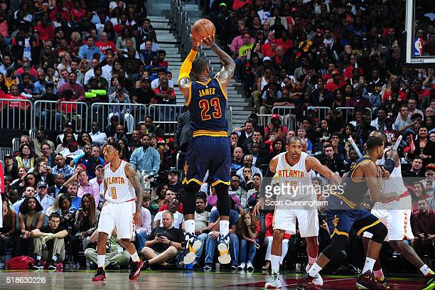 LeBron James of the Cleveland Cavaliers shoots the ball during the game against the Atlanta Hawks on April 1 2016 at Philips Arena in Atlanta Georgia...
