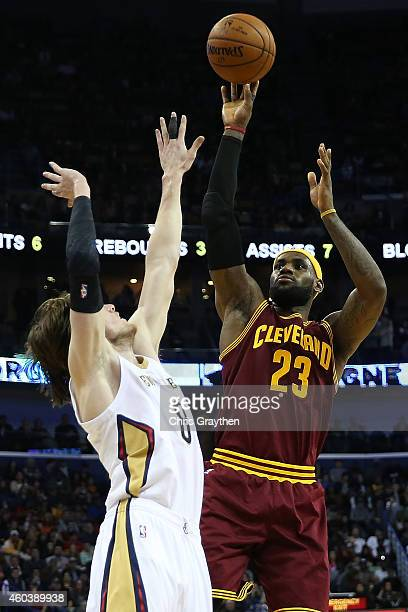 LeBron James of the Cleveland Cavaliers shoots the ball over Luke Babbitt of the New Orleans Pelicans at Smoothie King Center on December 12, 2014 in...