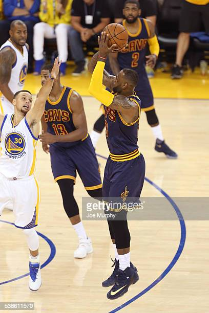LeBron James of the Cleveland Cavaliers shoots the ball over Stephen Curry of the Golden State Warriors during Game Two of the 2016 NBA Finals on...