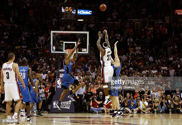 LeBron James of the Cleveland Cavaliers shoots the game winning three pointer over Hedo Turkoglu of the Orlando Magic in Game Two of the Eastern...