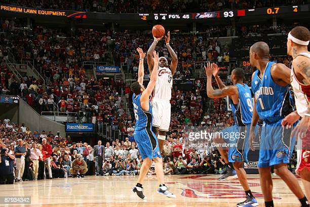 LeBron James of the Cleveland Cavaliers shoots the game-winning shot against Hedo Turkoglu of the Orlando Magic in Game Two of the Eastern Conference...