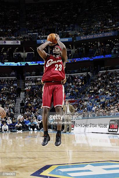 LeBron James of the Cleveland Cavaliers shoots the jump shot against the New Orleans Hornets during the game at New Orleans Arena on November 26 2003...