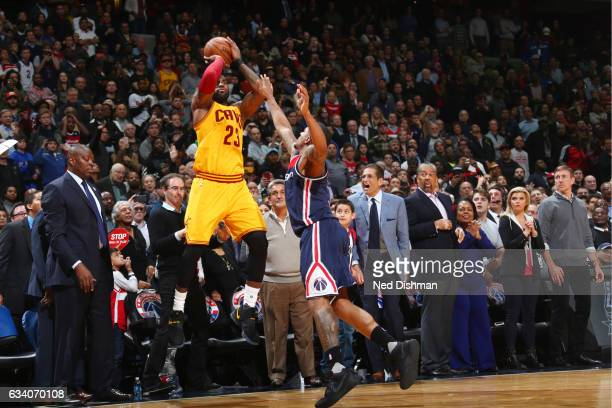 LeBron James of the Cleveland Cavaliers shoots the tiewinning shot during the game against the Washington Wizards on February 6 2017 at Verizon...