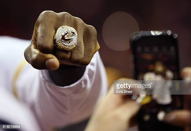 LeBron James of the Cleveland Cavaliers shows his championship ring before the game against the New York Knicks at Quicken Loans Arena on October 25...