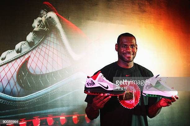 LeBron James of the Cleveland Cavaliers shows the new Nike shoes in a promotional event during a visit to China on August 24 2009 in Beijing China