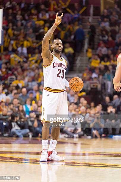 LeBron James of the Cleveland Cavaliers signals to his team during the second half against the Phoenix Suns at Quicken Loans Arena on March 7 2015 in...