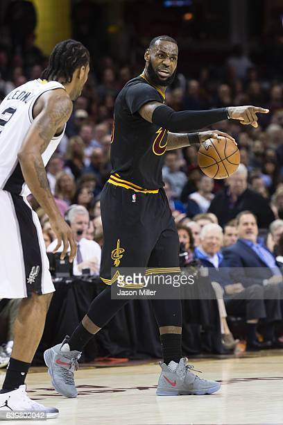 LeBron James of the Cleveland Cavaliers signals to his team during the first half against the San Antonio Spurs at Quicken Loans Arena on January 21...