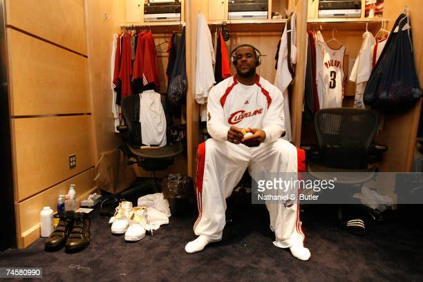 LeBron James of the Cleveland Cavaliers sits in front of his locker prior to Game Three of the NBA Finals against the San Antonio Spurs at the...
