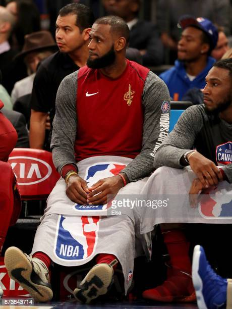 LeBron James of the Cleveland Cavaliers sits on the bench in the second quarter against the New York Knicks at Madison Square Garden on November 13...