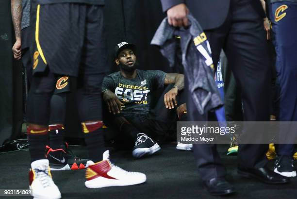 LeBron James of the Cleveland Cavaliers sits on the floor after defeating the Boston Celtics 8779 in Game Seven of the 2018 NBA Eastern Conference...
