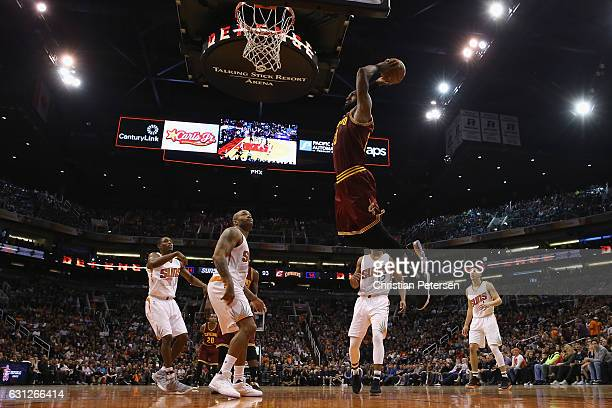 LeBron James of the Cleveland Cavaliers slam dunks the ball against the Phoenix Suns during the second half of the NBA game at Talking Stick Resort...