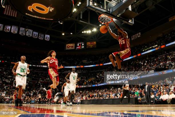 LeBron James of the Cleveland Cavaliers slam dunks the ball as teammate Anderson Varejao and Ray Allen and Kevin Garnett of the Boston Celtics look...