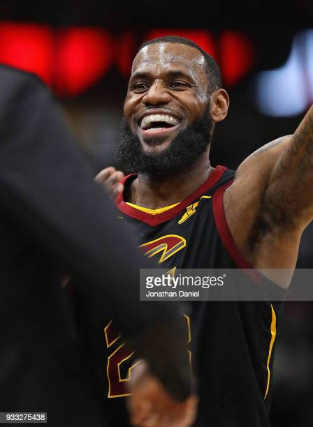 LeBron James of the Cleveland Cavaliers smiles as he leaves the court after hitting a shot late in the game against the Chicago Bulls at the United...