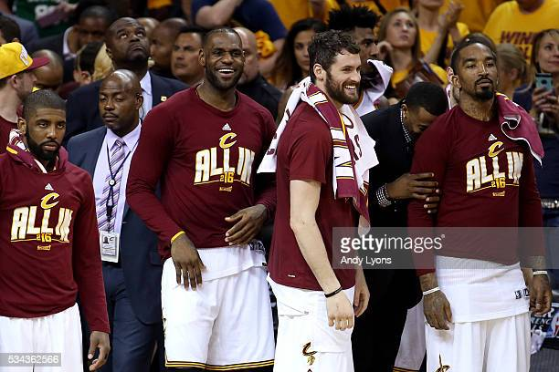 LeBron James of the Cleveland Cavaliers smiles with teammates Kyrie Irving Kevin Love and JR Smith after defeating the Toronto Raptors in game five...