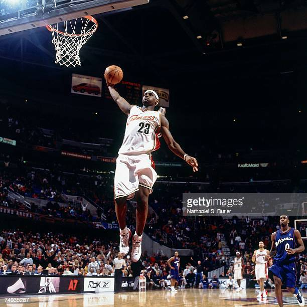 LeBron James of the Cleveland Cavaliers soars for a dunk against the Washington Wizards during a 2003 NBA game at the Quicken Loans Arena in...