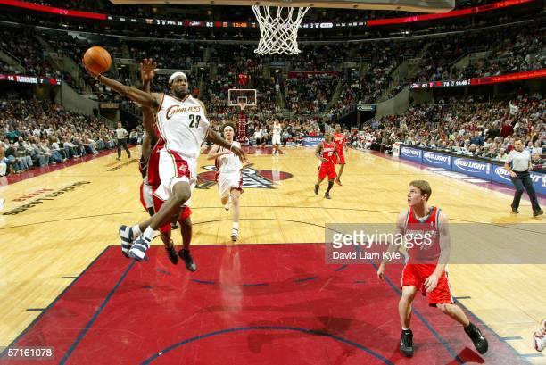 LeBron James of the Cleveland Cavaliers soars in for a dunk as Matt Carroll of the Charlotte Bobcats looks on on March 22 2006 at The Quicken Loans...