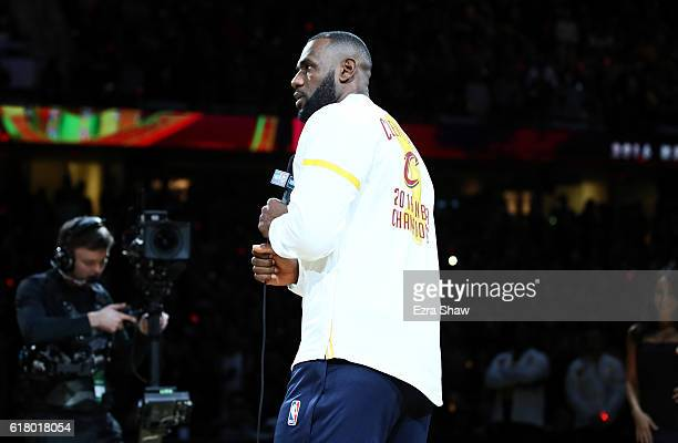 LeBron James of the Cleveland Cavaliers speaks after receiving his championship ring before the game against the New York Knicks at Quicken Loans...