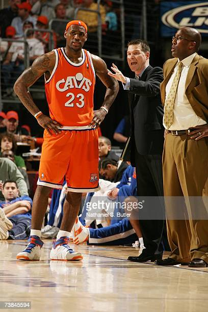 LeBron James of the Cleveland Cavaliers speaks to assistant coach Michael Malone during the game against the Dallas Mavericks at the Quicken Loans...