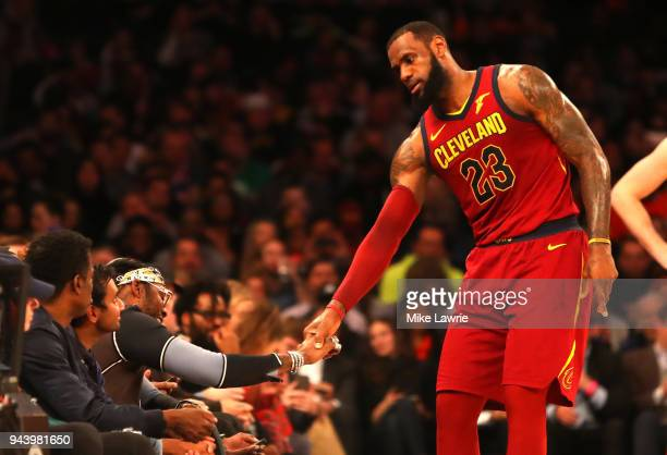 LeBron James of the Cleveland Cavaliers speaks to rapper 2 Chainz in the second half against the New York Knicks at Madison Square Garden on April 9...