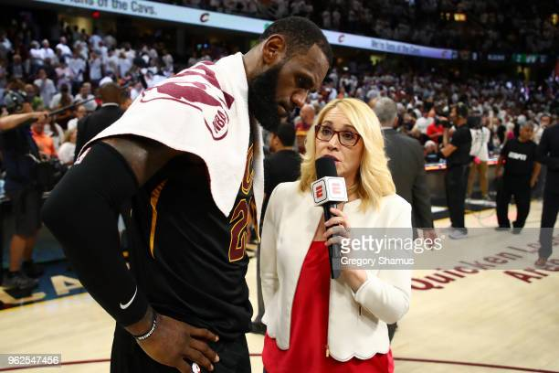 LeBron James of the Cleveland Cavaliers speaks to TV personality Doris Burke after defeating the Boston Celtics during Game Six of the 2018 NBA...