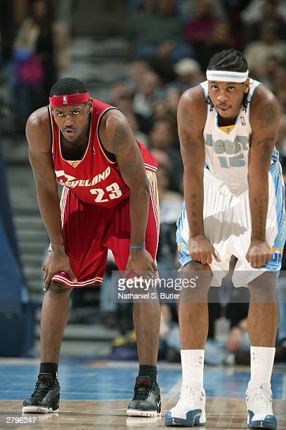 LeBron James of the Cleveland Cavaliers stands alongside Carmelo Anthony of the Denver Nuggets during the game at the Pepsi Center in Denver,...