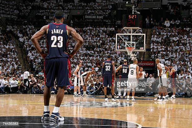 LeBron James of the Cleveland Cavaliers stands down court as teammate Drew Gooden waits to shoot a free throw attempt against the San Antonio Spurs...