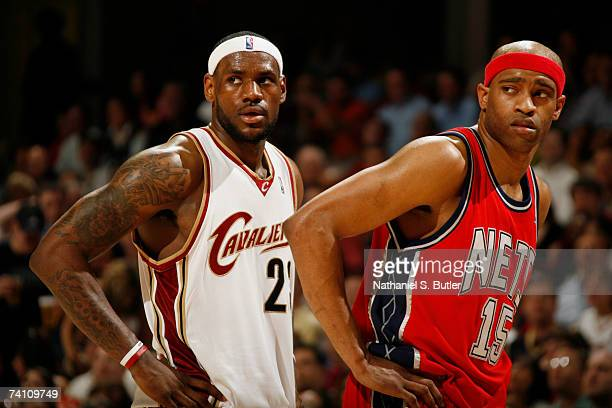 LeBron James of the Cleveland Cavaliers stands on the court with Vince Carter of the New Jersey Nets in Game Two of the Eastern Conference Semifinals...