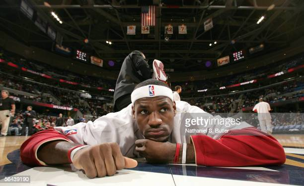 LeBron James of the Cleveland Cavaliers stretches prior to the game against the Denver Nuggets on December 15 2005 at the Quicken Loans Arena in...