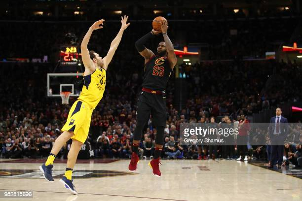 LeBron James of the Cleveland Cavaliers takes a shot behind Bojan Bogdanovic of the Indiana Pacers during the second half in Game Seven of the...