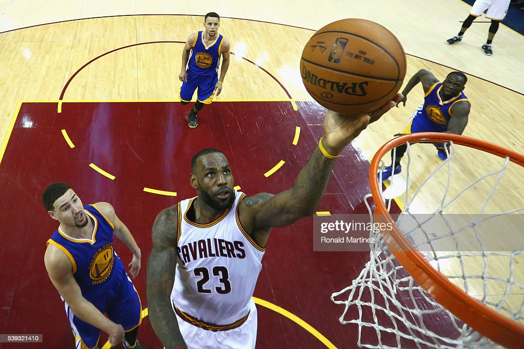 LeBron James #23 of the Cleveland Cavaliers takes a shot in front of Klay Thompson #11, Stephen Curry #30 and Draymond Green #23 of the Golden State Warriors in the fourth quarter in Game 4 of the 2016 NBA Finals at Quicken Loans Arena on June 10, 2016 in Cleveland, Ohio.
