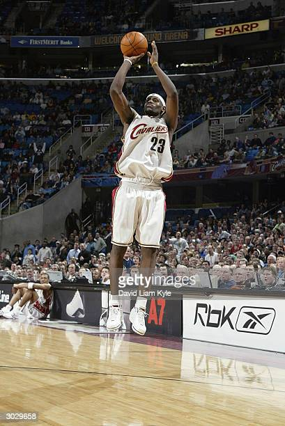 LeBron James of the Cleveland Cavaliers takes an open jump shot during the game against the New Orleans Hornets at Gund Arena on February 23 2004 in...