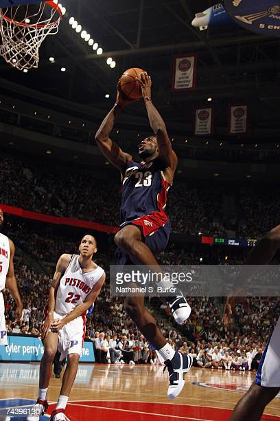 LeBron James of the Cleveland Cavaliers takes the ball to the basket past Tayshaun Prince of the Detroit Pistons in Game Five of the Eastern...