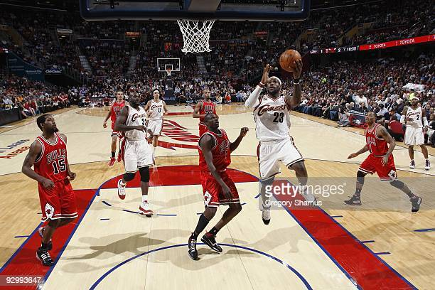 LeBron James of the Cleveland Cavaliers takes the ball to the basket against Luol Deng of the Chicago Bulls during the game on November 5, 2009 at...