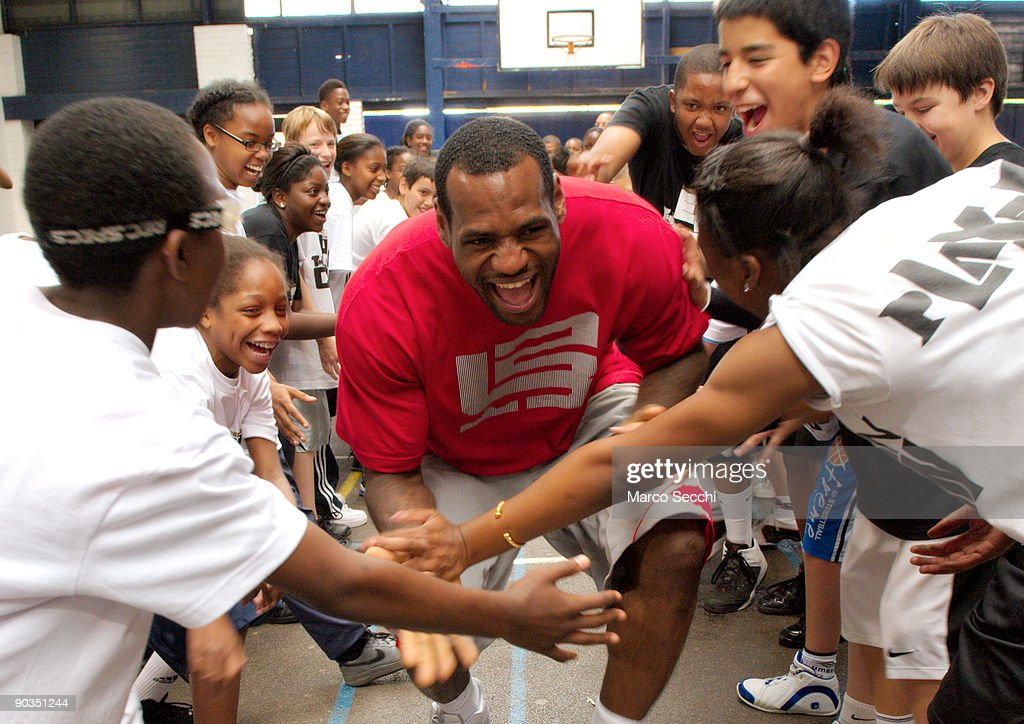 Lebron James #23 of the Cleveland Cavaliers talks to children during the Nike Lebron James Tour as he launches the New Basketball Legacy on September 5, 2009 in London, England.