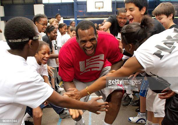 Lebron James of the Cleveland Cavaliers talks to children during the Nike Lebron James Tour as he launches the New Basketball Legacy on September 5...