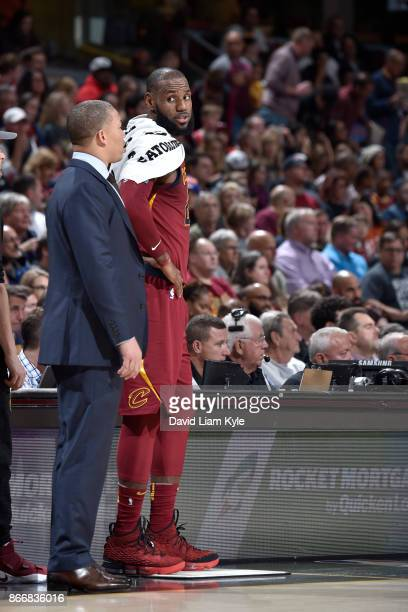 LeBron James of the Cleveland Cavaliers talks to head coach Tyronn Lue of the Cleveland Cavaliers on October 24 2017 at Quicken Loans Arena in...