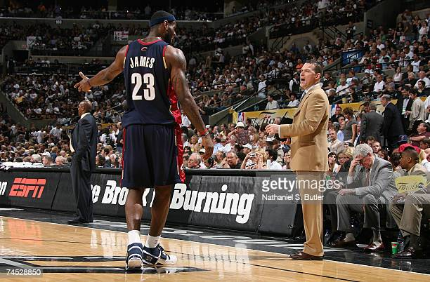 LeBron James of the Cleveland Cavaliers talks with assistant coach Michael Malone against the San Antonio Spurs in Game Two of the NBA Finals at the...