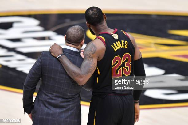 LeBron James of the Cleveland Cavaliers talks with head coach Tyronn Lue during Game Three of the 2018 NBA Finals against the Golden State Warriors...