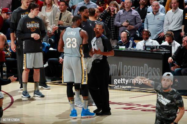 LeBron James of the Cleveland Cavaliers talks with Referee Eric Lewis during the game against the Philadelphia 76ers on March 1 2018 at Quicken Loans...